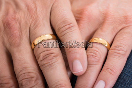 close up of hands with rings