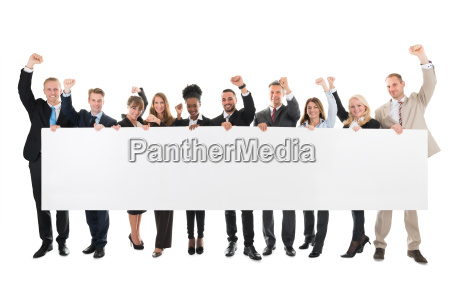 happy business team with arms raised