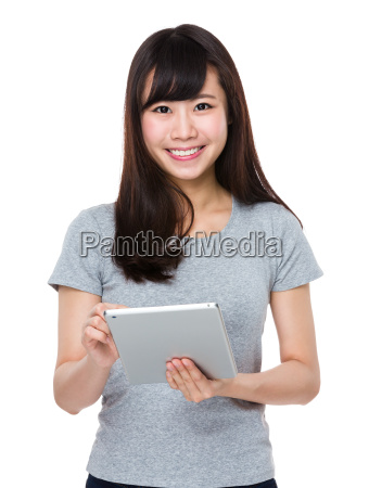 asian woman use of the tablet