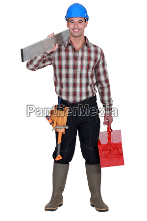 worker carrying an aluminium plank and