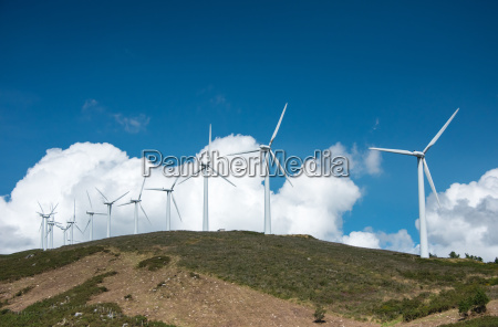 windmill powered plant on hilltop
