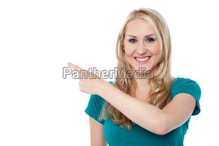 pretty cheerful lady indicating something