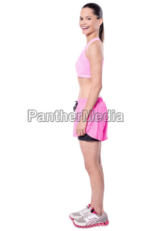 smiling pretty slim lady in sportswear