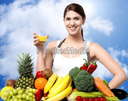 young woman drinking fruit juice