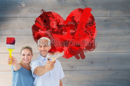 composite image of happy couple holding