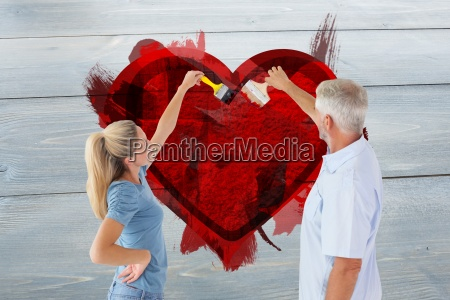 composite image of happy couple painting