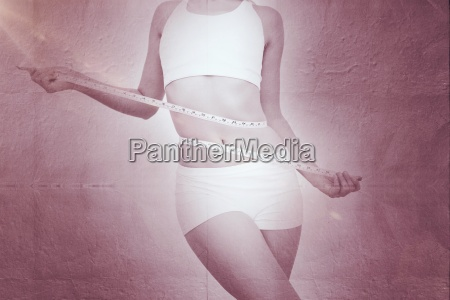 composite image of slim woman measuring