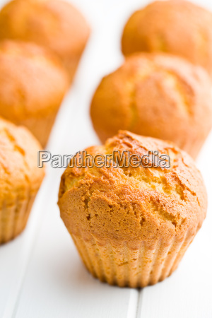 sweet muffins on kitchen table