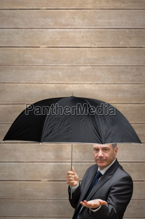 composite image of mature businessman holding