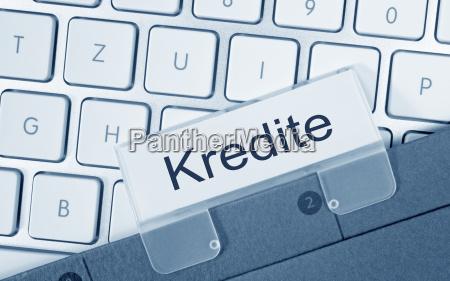 kredite ordner auf computer tastatur