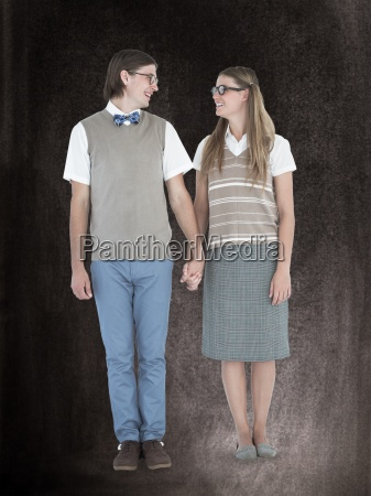composite image of geeky hipster couple