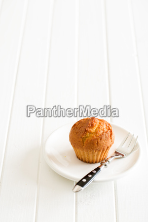 sweet muffin on kitchen table
