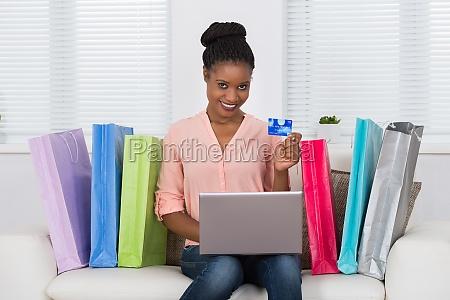 woman using debit card for shopping