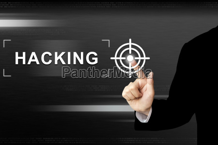 business hand pushing hacking button on