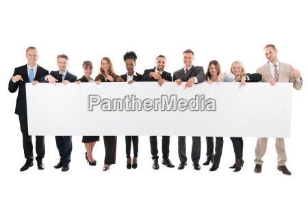 happy business team pointing at blank
