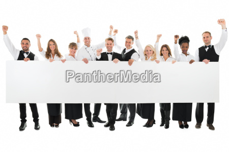 happy restaurant staff holding blank billboard
