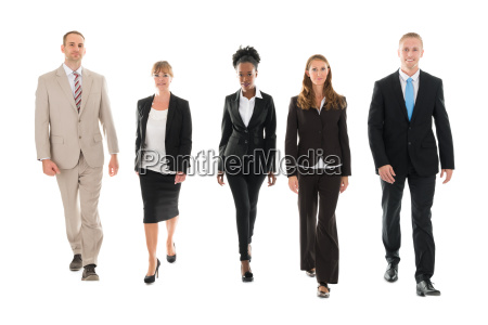 confident business team walking against white