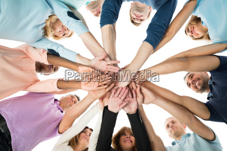 creative business team stacking hands in