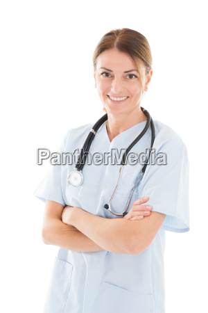 happy female doctor standing arms crossed