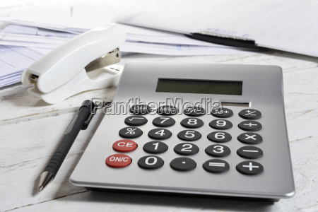calculator and stapler on a white