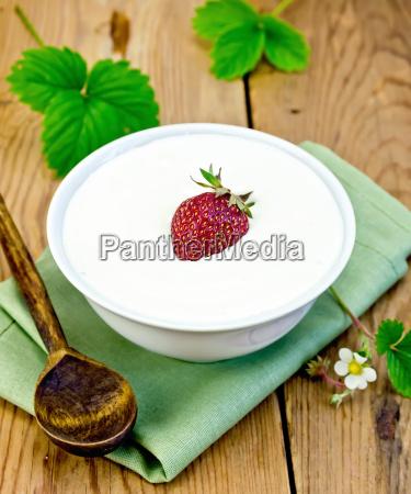 yogurt thick with strawberries in bowl