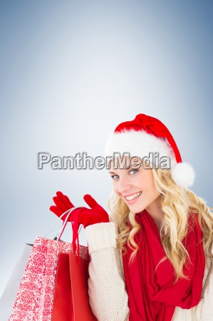 happy festive blonde with shopping bags
