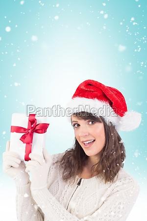 composite image of festive brunette showing