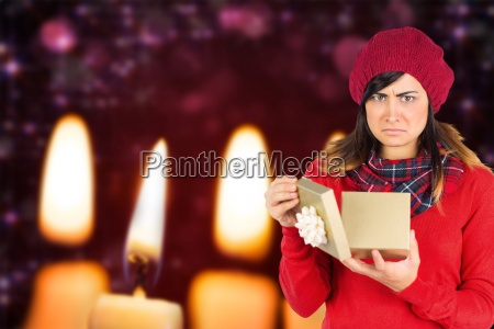 composite image of unhappy brunette opening