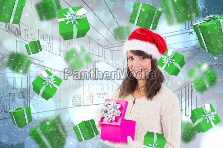 composite image of brunette opening christmas