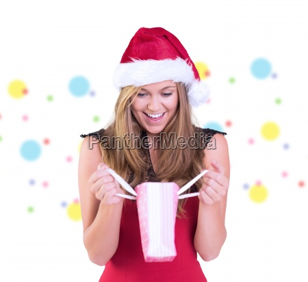 composite image of festive blonde opening