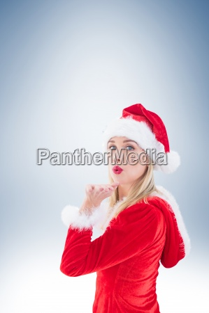 festive blonde blowing a kiss