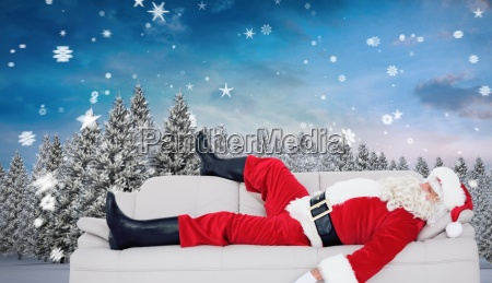 composite image of santa claus sleeping