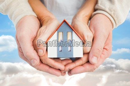 composite image of couple holding small