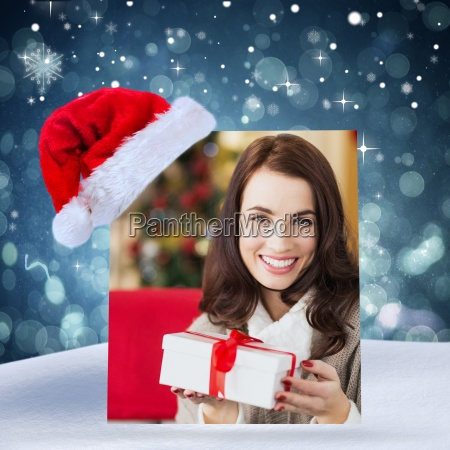 composite image of smiling brunette holding