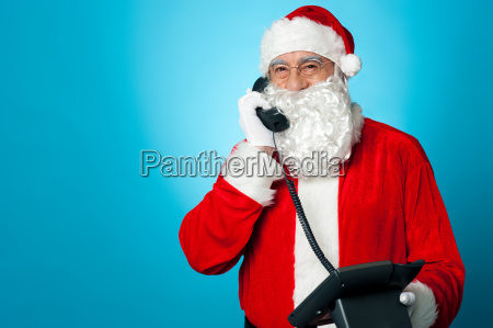 aged man in santa claus costume