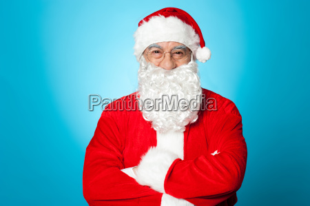 arms crossed santa claus over blue