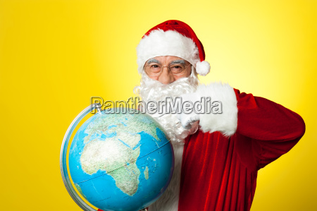 ages man in santa costume holding