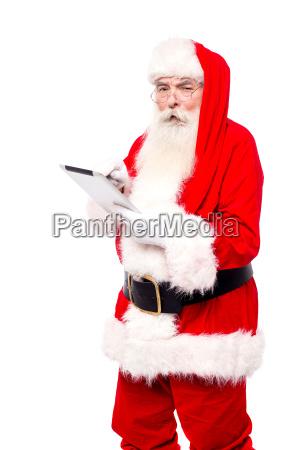 santa surfing wen on tablet