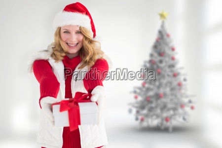 composite image of festive blonde giving