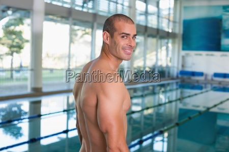 fit swimmer by the pool at