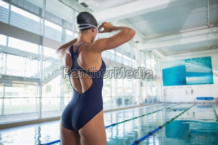 rear view of a fit swimmer