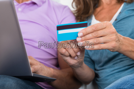couple with laptop and credit card