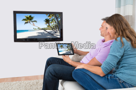couple using digital tablet for watching