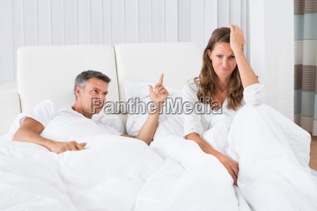 couple arguing in the bedroom