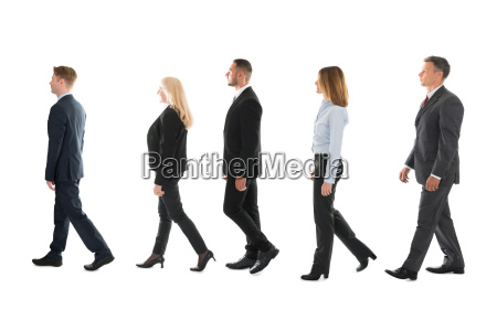 business people walking against white background