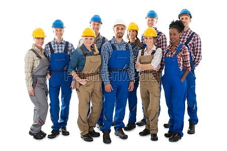 full length portrait of happy carpenters