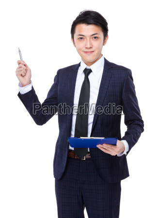 businessman hold with clipboard and pen