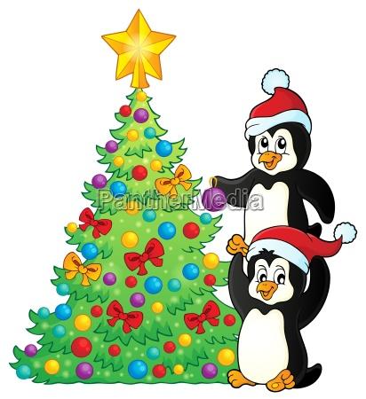 pinguine in der naehe von weihnachtsbaum