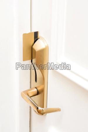 door lock secured key card inserted