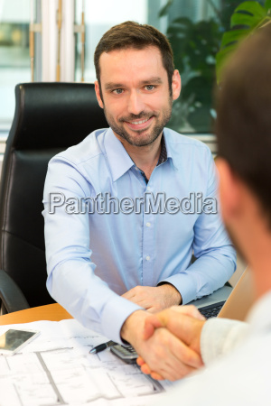 real estate agent meeting couple at